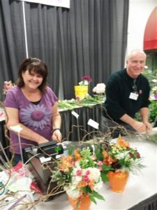 Jeanna Furst, AIFD, and Michael Brown, AIFD, ringing up the flower sales